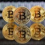 Bitcoin rallies to new record, market cap hits $50 billion for first time